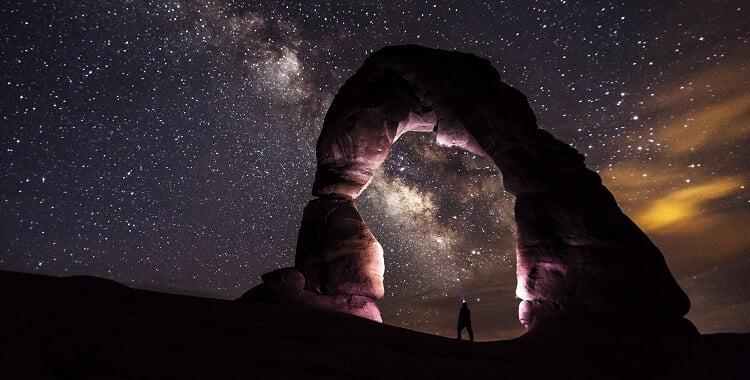 stone arch under a starry sky